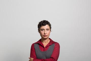 studio portrait of a businesswoman contemplating