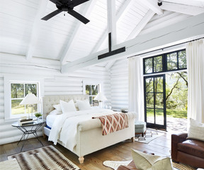 Interior view of modern bedroom in log cabin
