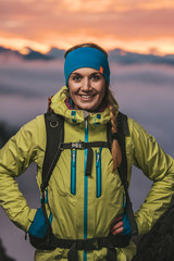 portrait of a beautiful sporty woman in alpine scenery at sunset