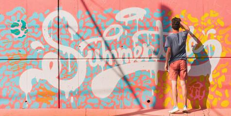"""Graffiti artist working on """"Summertime"""" graffiti/mural"""