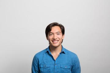 studio portrait of a happy young man