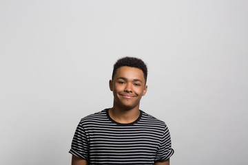 studio portrait of a happy young man