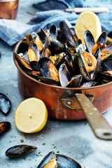 Cooked mussels in a copper pot