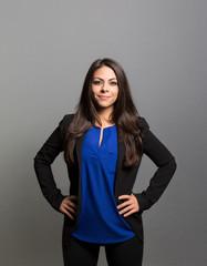 studio portrait of a prideful businesswoman