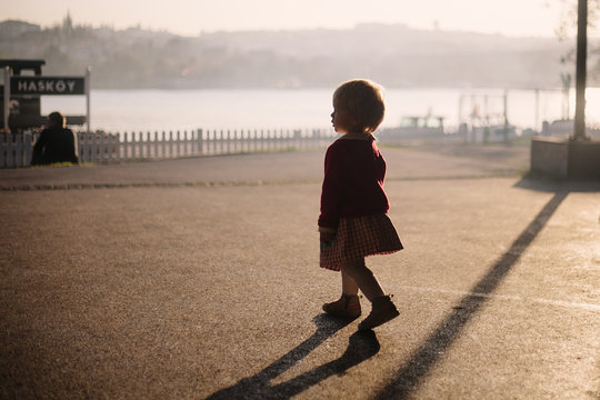 Girl walking by the Golden Horn in Huskly, Istanbul