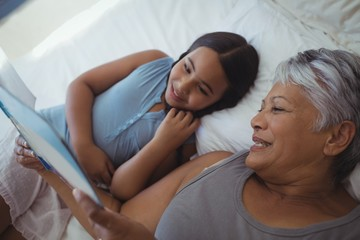 Grandmother and granddaughter watching photo