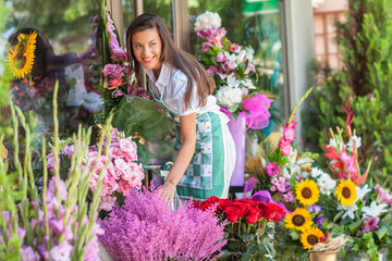 Florist standing in front of the flower shop