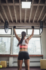 Woman Holding a Weight in the Gym