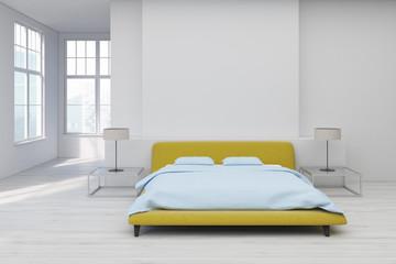 Yellow bed, white floor