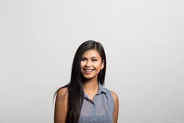 studio portrait of an excited young woman