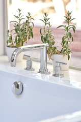 Bathtub faucet in bathroom