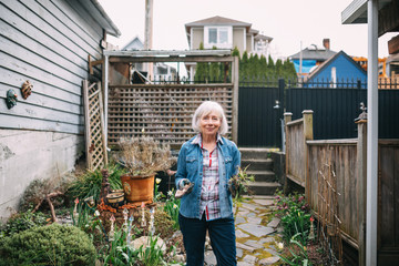 Portrait of older woman after gardening in her backyard