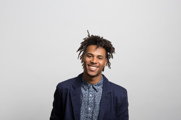 studio portrait of an excited young man