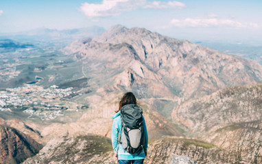 Female Hiker on a mountain summit enjoying the view