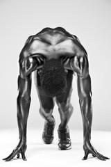 Sprinter african man in starting position