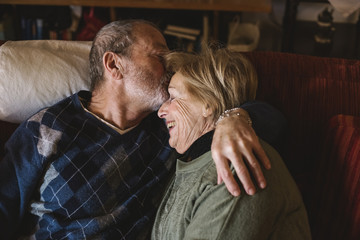 Happy and playful senior couple together at home