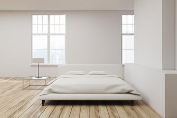 White bed wooden floor