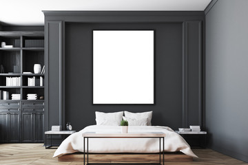 Black bedroom interior, poster close up