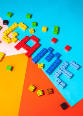 "Word ""Game"" made with stuck blocks for kids on colorful background"