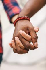Multi ethnic couple holding hands