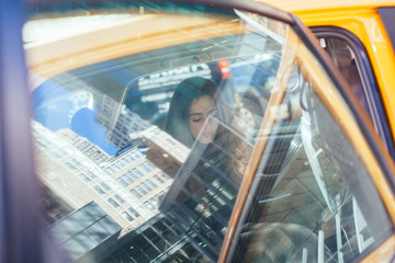 Beautiful Woman sitting in a Taxi in New York City