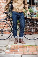 Hipster millennial on bike in urban area