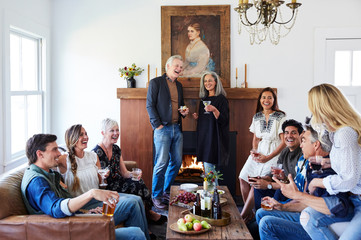Group of friends and family having a cocktail party in their home