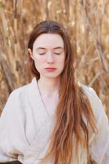 Woman meditating at hot springs and spa