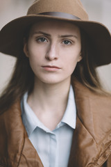 portrait of young woman with hat