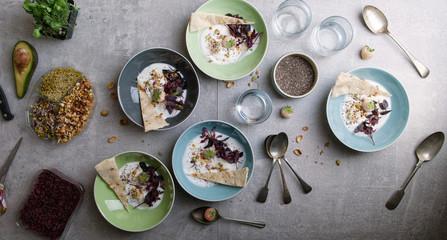 Preparing breakfast Healthy yogurt breakfast being prepared on kitchen table