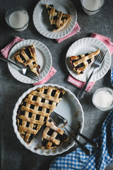 Blueberry and cherry pie served with milk on table Seen from above