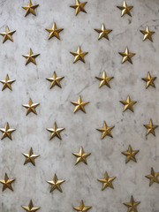 Gold stars background on marble wall