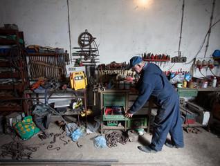 Old craftsman in his workshop