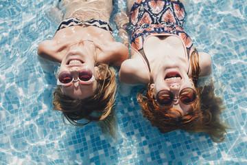 Girls Having Fun at the Swimming Pool
