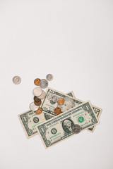 Overhead view of  US Dollar bills and coins on white background
