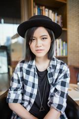 Cute Asian woman looking at camera