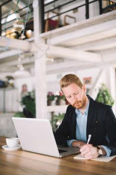 Businessman Writing on a Legal Pad