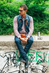 Man sitting on graffiti wall