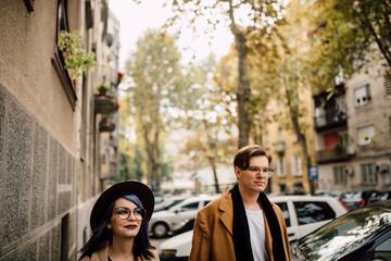 Young beautiful couple walking outdoors