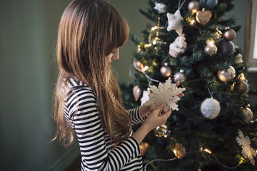 Cute Girl Decorating the Christmas Tree