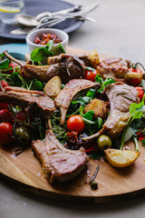 Lamb chops with roasted potatoes and olives