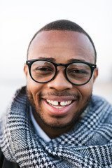 Closeup portrait of an african american man smiling on winter