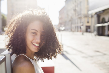 Portrait of beautiful curly woman  smiling