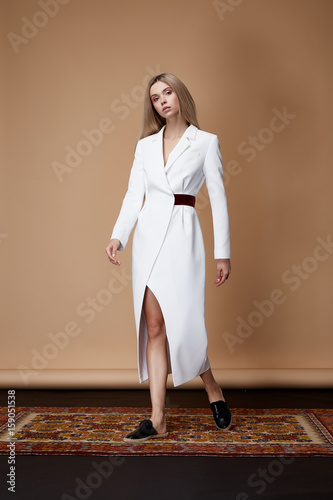 eb1c0e8815662 Fashion model pose fore catalog summer collection designer clothes casual  white long dress office party walk meeting pretty beauty woman sexy blonde  hair ...