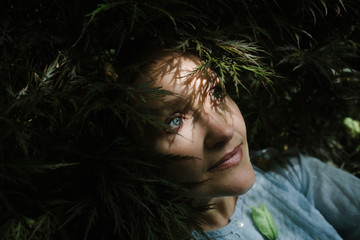 Portrait of a woman resting in nature