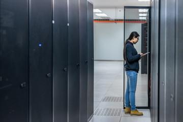 Female technician working in data center