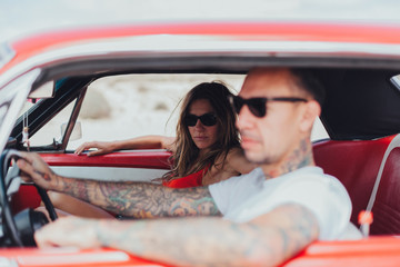 Couple Traveling with an American Vintage Car