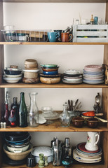 Dresser with plates and various kitchen utensils