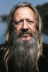 portrait of an old fishermen with long hair and white beard