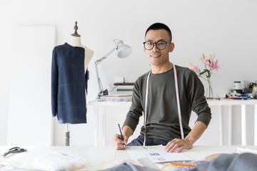 Portrait of fashion designer in studio